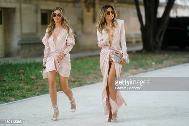 Maja Malnar wears sunglasses a lustrous pale pink satin drape mini dress with a plunging neckline legofmutton sleeves and a bejeweled buckle silver...
