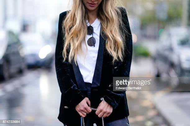 Maja Malnar wears Vans black and white sneakers shoes an Acne white shirt Topshop black denim lace up denim jeans a Les Petits Joueurs blue bag with...