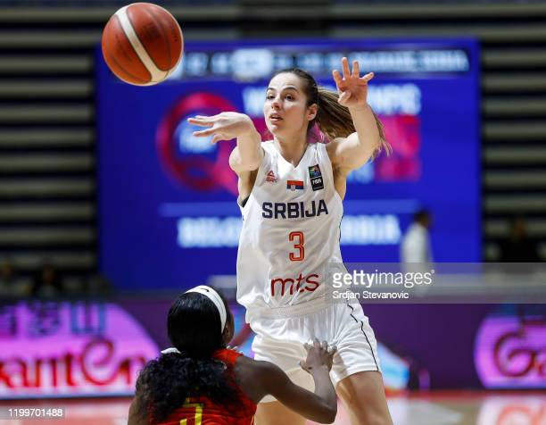 Maja Miljkovic of Serbia competes for the ball against Delma Zita of Mozambique during the FIBA Women's Olympic Qualifying Tournament 2020 Group B...