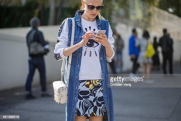 Maja Salamon looks at her smartphone during the Paris Fashion Week Womenswear Spring/Summer 2016 on October 4 2015 in Paris France