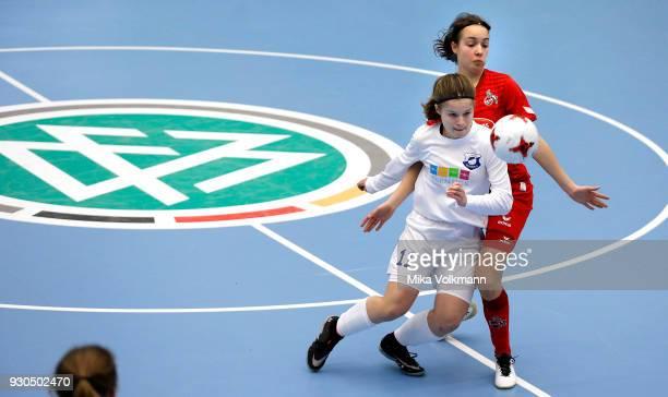 Maja Wasiak of Berlin challenges Esther Juretzka of Koeln during the DFBFutsalCup half final match between 1FC Koeln vs SV Adler Berlin on March 11...