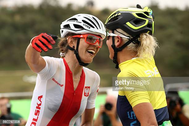 Maja Wloszczowska of Poland and Jenny Rissveds of Sweden celebrate after finishing the Women's CrossCountry Mountain Bike Race on Day 15 of the Rio...
