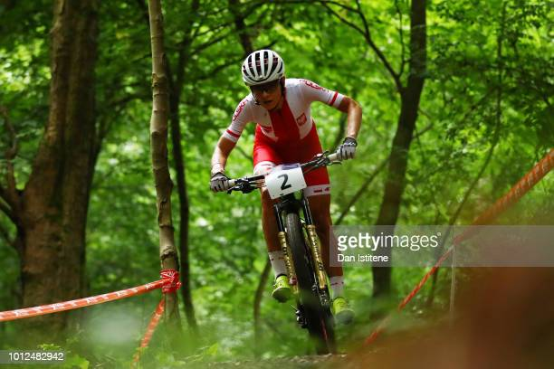 Maja Wloszczowska of Poland rides during the Women's Mountain Bike Cross-Country on Day Six of the European Championships Glasgow 2018 at Cathkin...