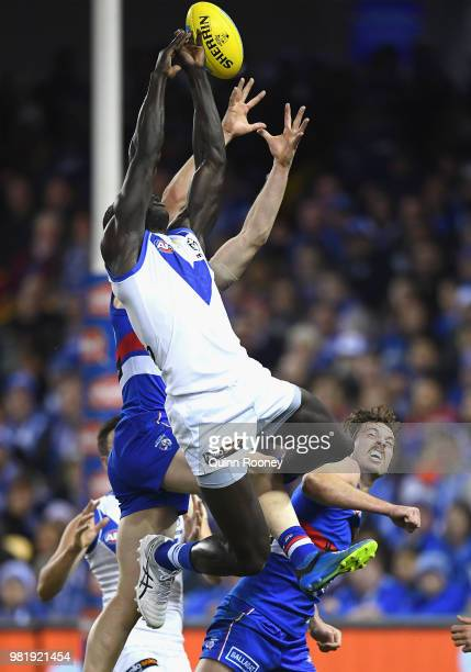 Majak Daw of the Kangaroos attempts to mark during the round 14 AFL match between the Western Bulldogs and the North Melbourne Kangaroos at Etihad...