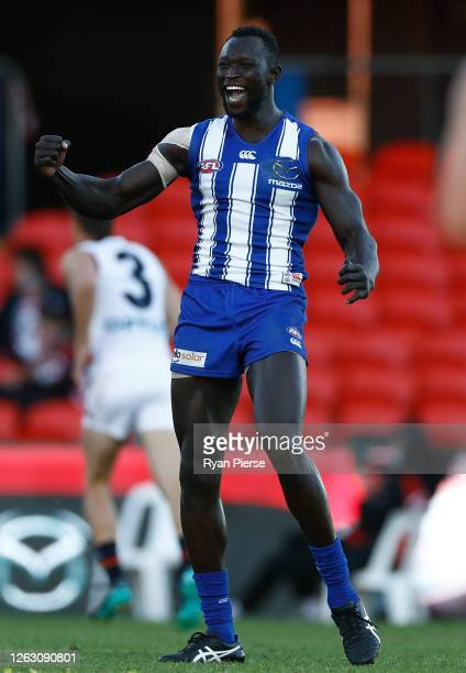 Majak Daw of the Kangaroos celebrates after scoring a goal during the round nine AFL match between North Melbourne Kangaroos and the Adelaide Crows...