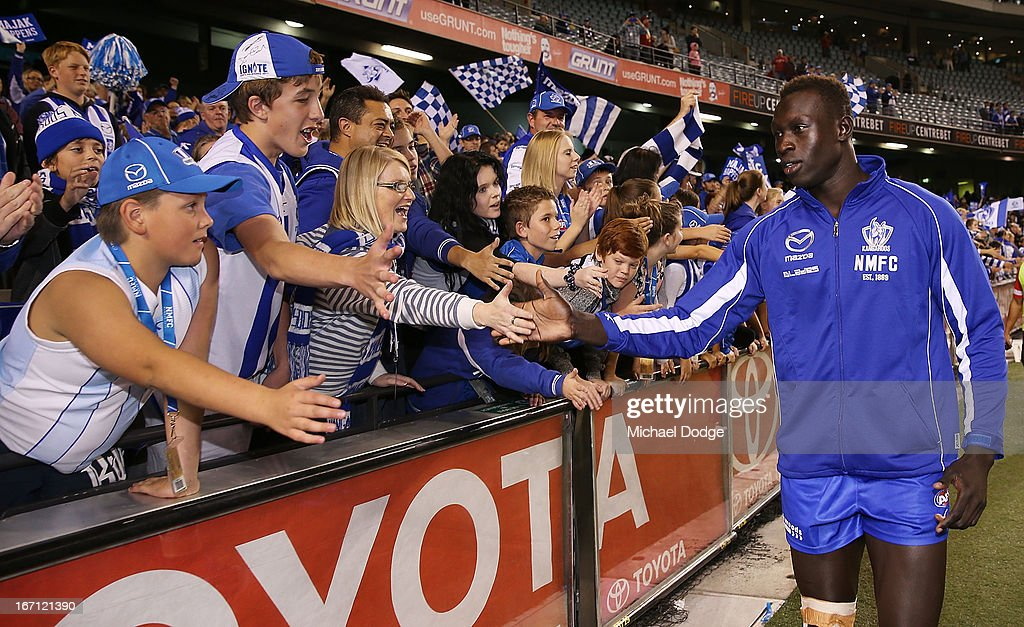 Majak Daw of the Kangaroos celebrates the win with the fans during the round four AFL match between the North Melbourne Kangaroos and the Brisbane Lions at Etihad Stadium on April 21, 2013 in Melbourne, Australia.