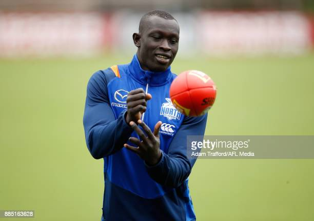 Majak Daw of the Kangaroos in action during the North Melbourne Kangaroos training session at Arden St on December 4 2017 in Melbourne Australia