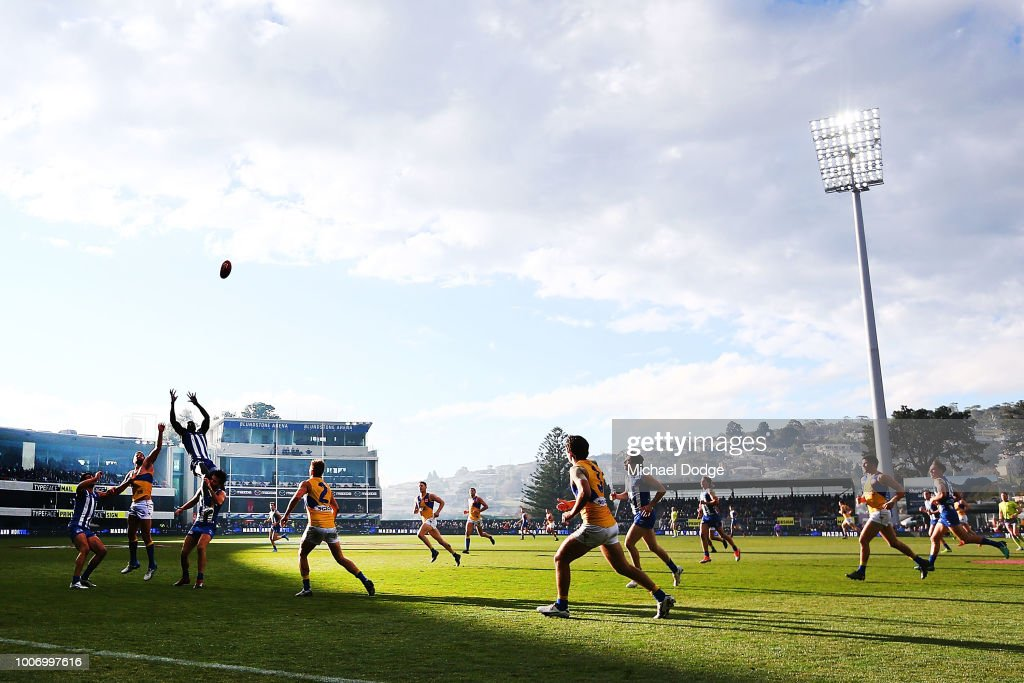 Majak Daw of the Kangaroos leaps for a high mark attempt during the round 19 AFL match between the North Melbourne Kangaroos and the West Coast Eagles at Blundstone Arena on July 29, 2018 in Hobart, Australia.