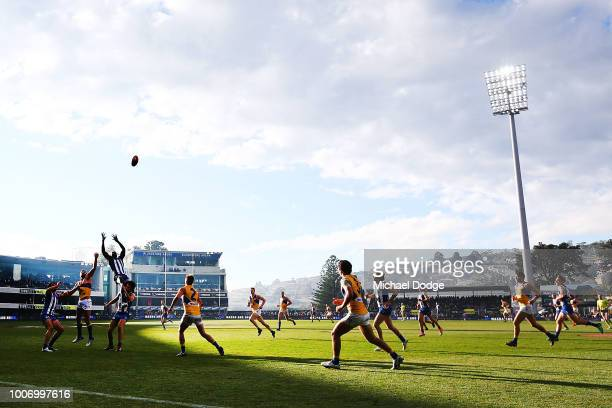 Majak Daw of the Kangaroos leaps for a high mark attempt during the round 19 AFL match between the North Melbourne Kangaroos and the West Coast...