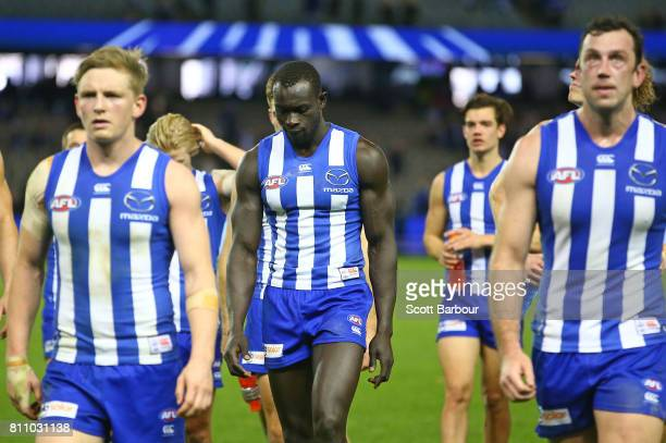 Majak Daw of the Kangaroos leaves the field with his teammates after losing the round 16 AFL match between the North Melbourne Kangaroos and the...