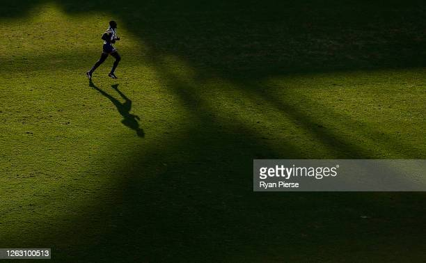 Majak Daw of the Kangaroos looks on during the round nine AFL match between North Melbourne Kangaroos and the Adelaide Crows at Metricon Stadium on...