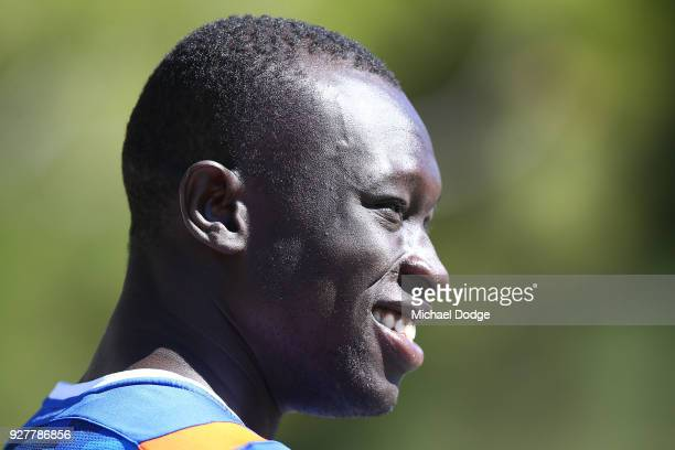 Majak Daw of the Kangaroos looks upfield during a North Melbourne Kangaroos AFL training session at Arden Street Ground on March 6 2018 in Melbourne...