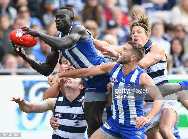Majak Daw of the Kangaroos marks during the round 12 AFL match between the Geelong Cats and the North Melbourne Kangaroos at GMHBA Stadium on June 9...