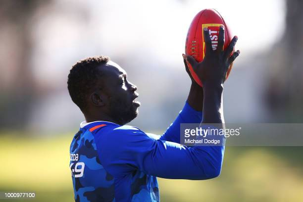 Ben Jacobs of the Kangaroos out with concussion for several weeks marks the ball one handed during a North Melbourne Kangaroos AFL training session...