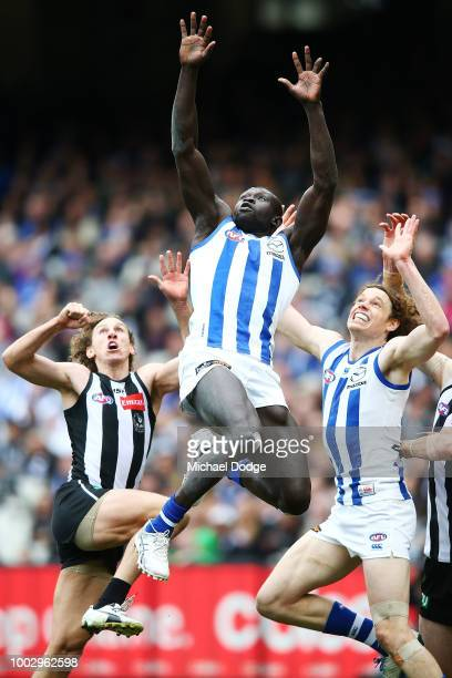 Majak Daw of the Kangaroos marks the ball during the round 18 AFL match between the Collingwood Magpies and the North Melbourne Kangaroos at...