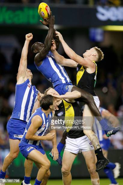 Majak Daw of the Kangaroos marks the ball during the round eight AFL match between the North Melbourne Kangaroos and the Richmond Tigers at Etihad...