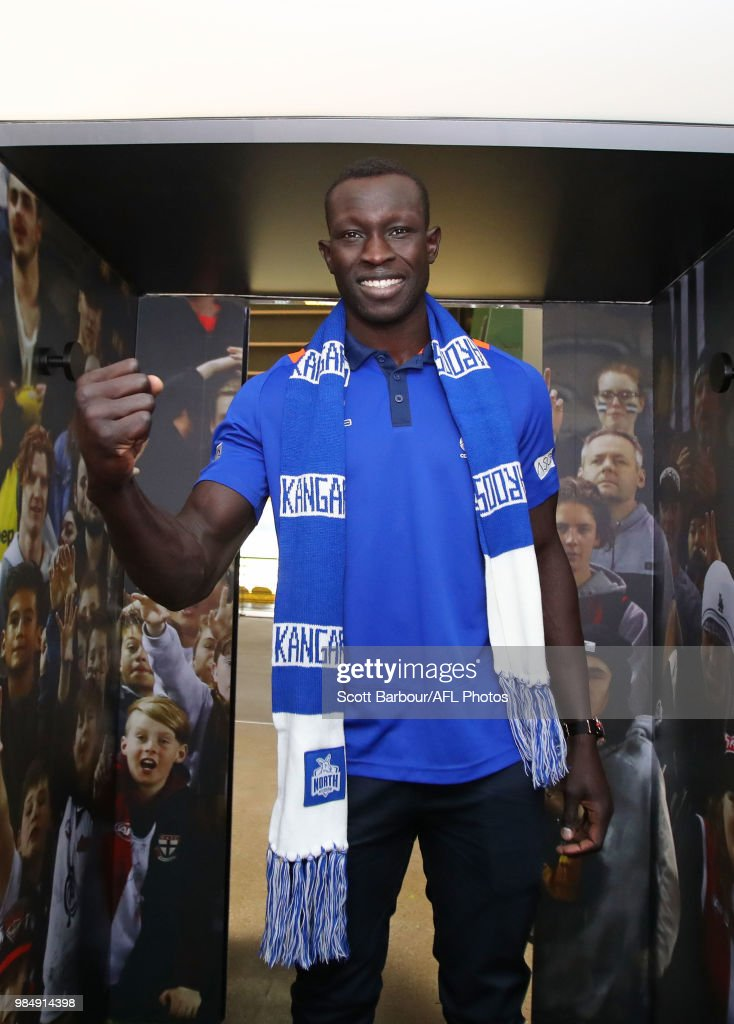 Majak Daw of the Kangaroos poses inside of the the Scream-a-Meter during the Simply Energy AFL and Etihad Stadium Announcement at Etihad Stadium on June 26, 2018.