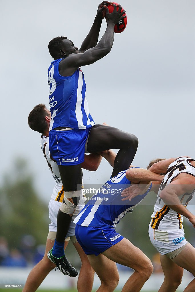 Majak Daw of the Kangaroos takes a high mark during the AFL NAB Cup match between the North Melbourne Kangaroos and the Hawthorn Hawks at Highgate Recreational Reserve on March 16, 2013 in Craigieburn, Australia.