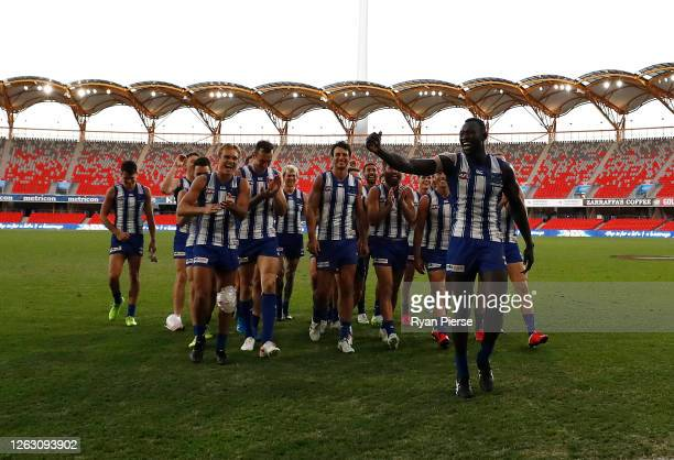 Majak Daw of the Kangaroos waves to the fans after the Kangaroos defeated the Crows the round nine AFL match between North Melbourne Kangaroos and...