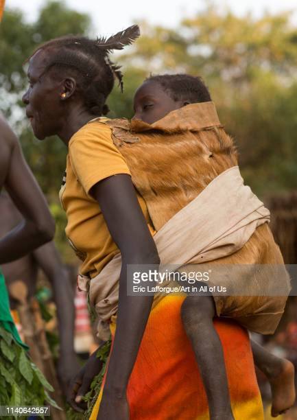 Majang tribe woman with her baby Kobown Ethiopia on December 22 2013 in Kobown Ethiopia