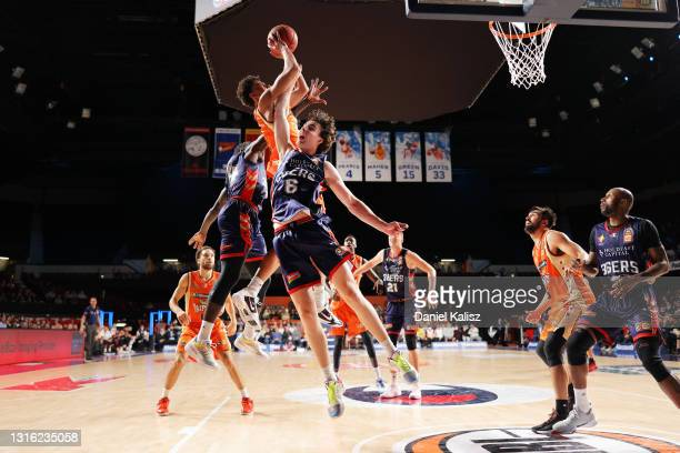 Majave King of the Cairns Taipans is defended by Josh Giddey of the Adelaide 36ers during the round 16 NBL match between the Adelaide 36ers and...