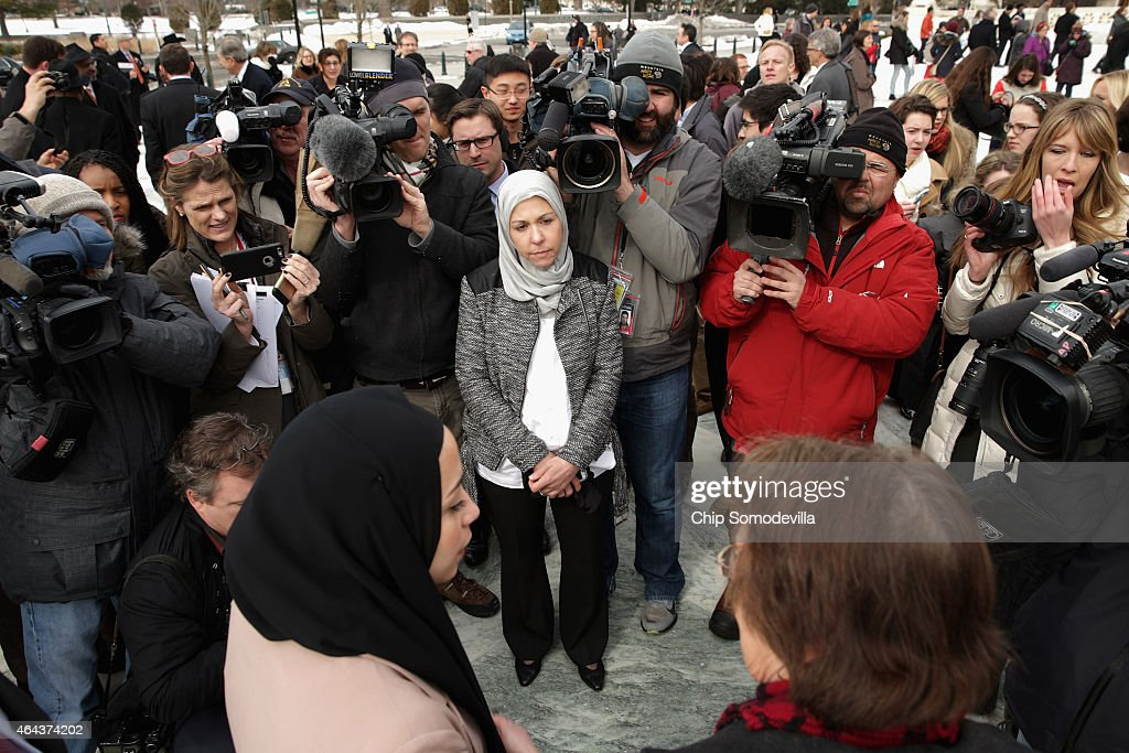 Majda Elauf (C with grey scarf) of Tulsa, Oklahoma, is surrounded by journalists as they interview her daughter, Samantha Elauf, outside the U.S. Supreme Court after the court heard oral arguments in EEOC v. Abercrombie & Fitch February 25, 2015 in Washington, DC. Elauf filed a charge of religious discrimination with the Equal Employment Opportunity Commission saying Abercrombie & Fitch violated discrimination laws in 2008 by declining to hire her because she wore a head scarf, a symbol of her Muslim faith.