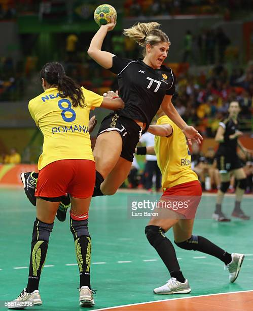 Majda Mehmedovic of Montenegro is challenged by Cristina Neagu of Romania during the Womens Preliminary Group A match between Romania and Montenegro...