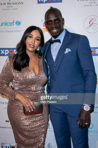 Majda Sakho and husband Mamadou Sakho attend the Global Gift Gala 2019 at Four Seasons Hotel George V on June 03 2019 in Paris France