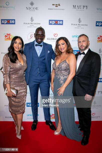 Majda Sakho Mamadou Sakho Maria Bravo and Thierry Martino attend the Global Gift Gala 2019 at Four Seasons Hotel George V on June 03 2019 in Paris...