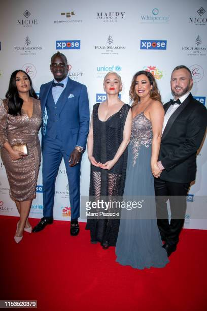 Majda Sakho Mamadou Sakho Rose McGowan Maria Bravo and Thierry Martino attend the Global Gift Gala 2019 at Four Seasons Hotel George V on June 03...