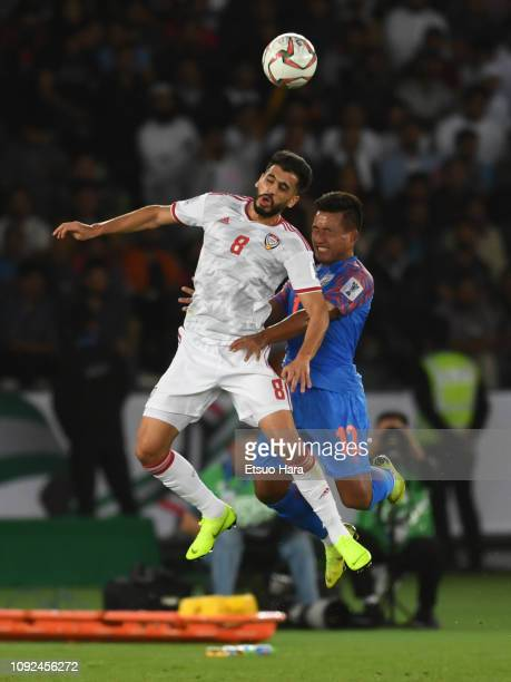 Majed Hassan Ahmed of United Arab Emirates and Lalpekhlua Jeje of india compete for the ball during the AFC Asian Cup Group A match between India and...