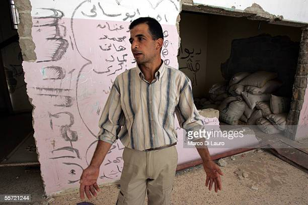 Majed Kishta 35yearsold stands in his almost demolished house on September 19 2005 in Rafah refugee camp Gaza Strip Majed's house has been allegedly...