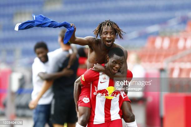Majeed Ashimeru and Patson Daka of Salzburg celebrating the win of the austrian bundesliga trophy after the tipico Bundesliga match between Red Bull...