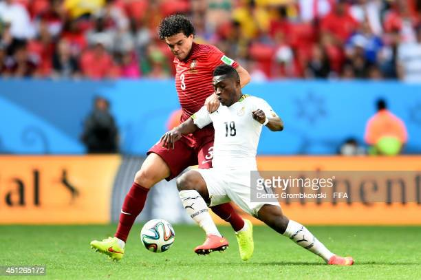 Majeed Waris of Ghana and Pepe of Portugal compete for the ball during the 2014 FIFA World Cup Brazil Group G match between Portugal and Ghana at...