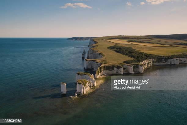 majestic aerial view of old harry rocks at sunset, dorset, england, united kingdom - küstenlandschaft stock-fotos und bilder