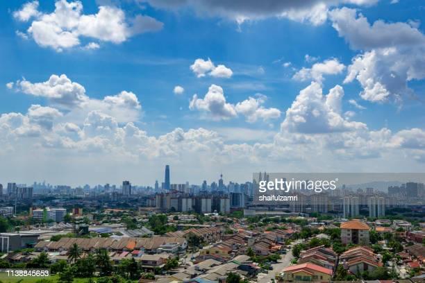 Majestic and fluffy monsoon clouds over downtown Kuala Lumpur, Malaysia.