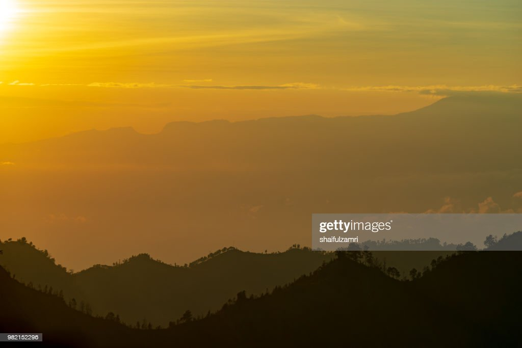 Majestic and misty sunrise over mountain range at Bromo Tengger Semeru National Park, Indonesia. : Stock Photo