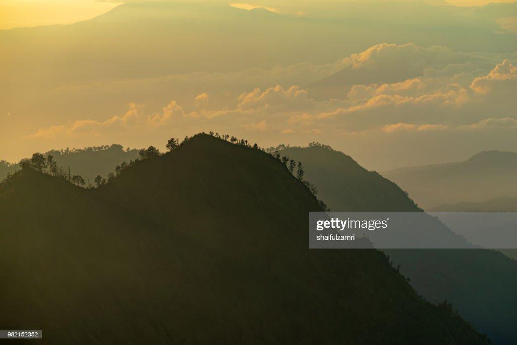 Majestic and misty sunrise over mountain range at Bromo Tengger Semeru National Park, Indonesia. : Stock Photo