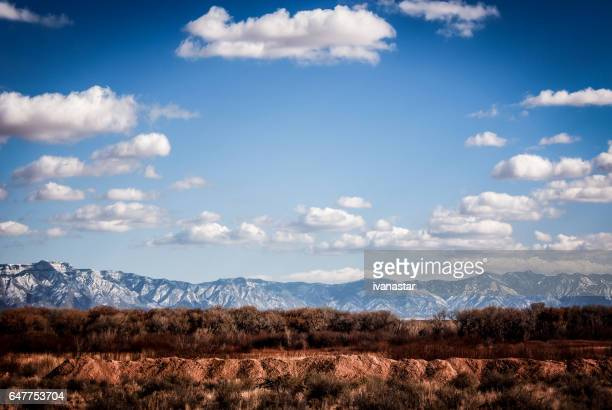 majestic cloudscape over sandia mountains in new mexico - sandia mountains stock photos and pictures