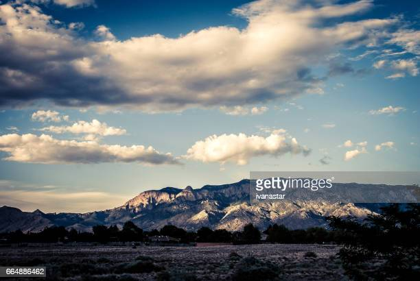 majestic  cloudscape over sandia mountains - sandia mountains stock pictures, royalty-free photos & images