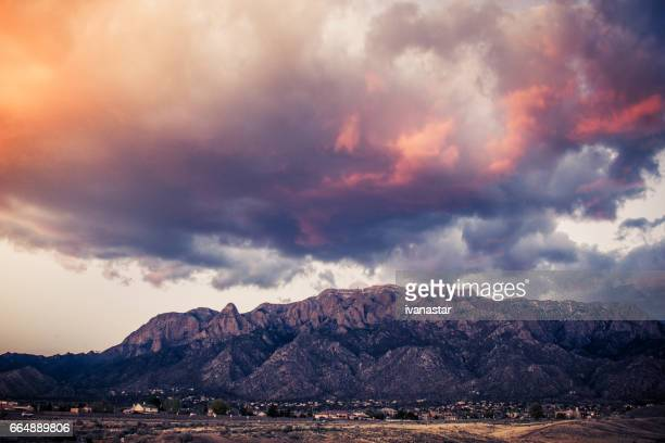 majestic  cloudscape over sandia mountains - sandia mountains stock photos and pictures