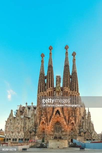 Majestic facade of Sagrada Familia basilica at early sunset in Barcelona, Catalonia, Spain, a UNESCO heritage site