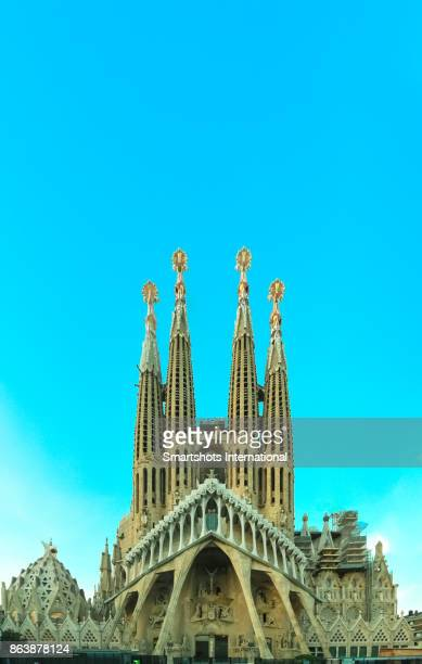 Majestic facade of Sagrada Familia basilica with sunset lights in Barcelona, Catalonia, Spain, a UNESCO heritage site
