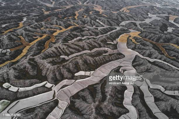 Majestic field patterns in the mountains seen from above, Aragon, Spain