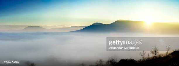 Majestic fog ocean in the mountains on sunset, Alsace, France