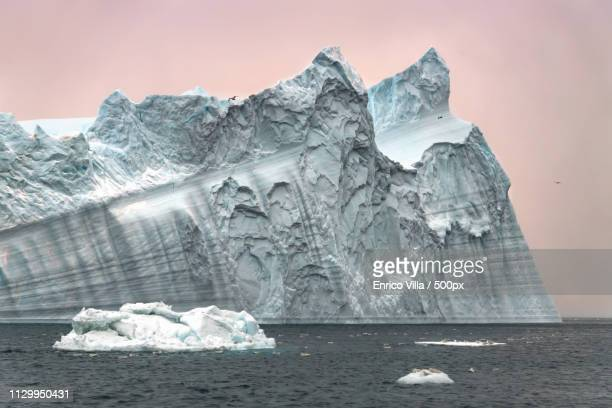 majestic iceberg in ilulissat icefjord - ilulissat stock-fotos und bilder
