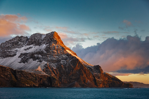Majestic landscape with rocky mountain by sea, South Georgia Island, Antarctica - gettyimageskorea