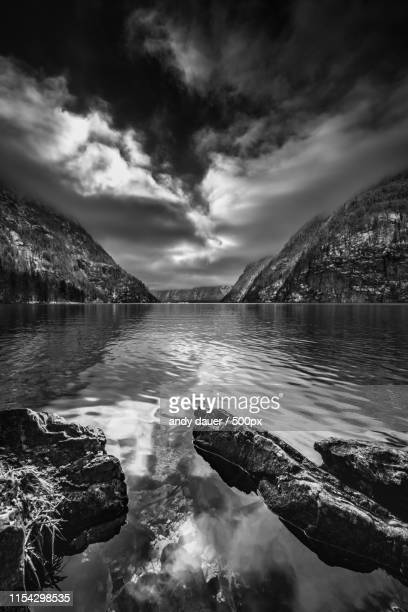 majestic landscape with view of lake and mountains - andy dauer stock photos and pictures