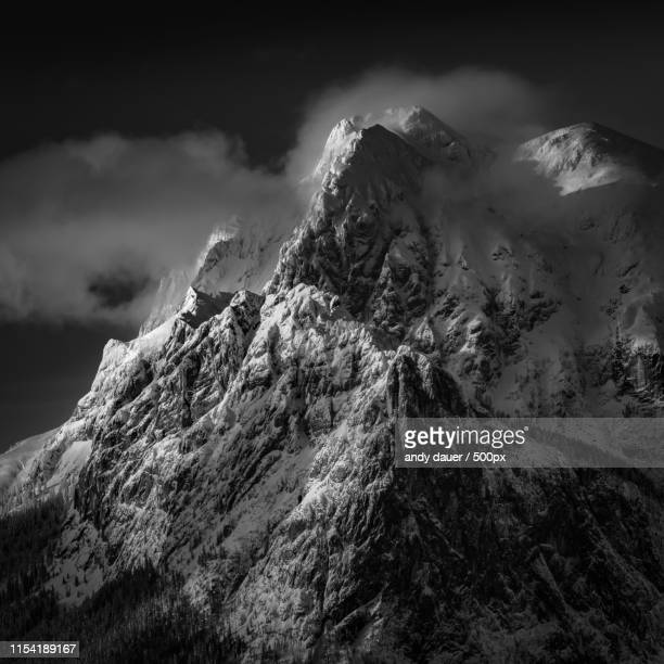 majestic landscape with view of mountains in winter - andy dauer stock photos and pictures