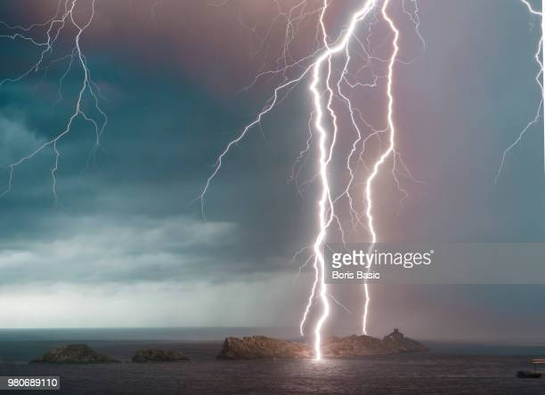 majestic lightings piercing dark sky - アドリア海 ストックフォトと画像